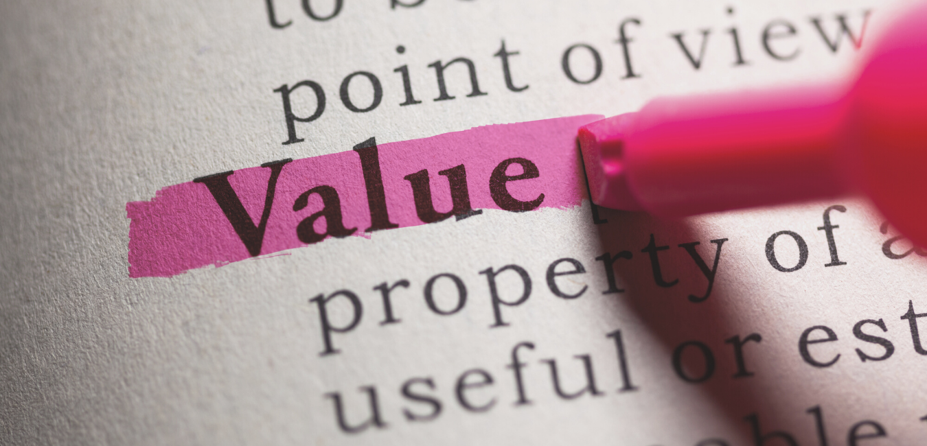 Close up of the word value that is highlighted in pink in a book