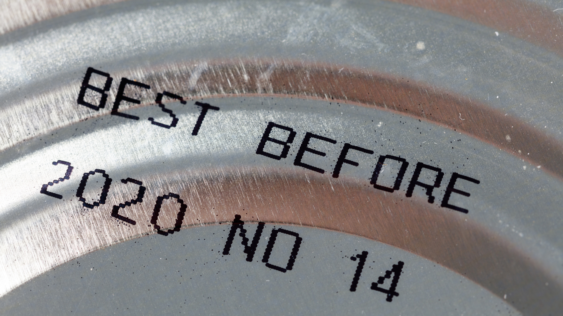 Zoom up of a can of food with a best before date