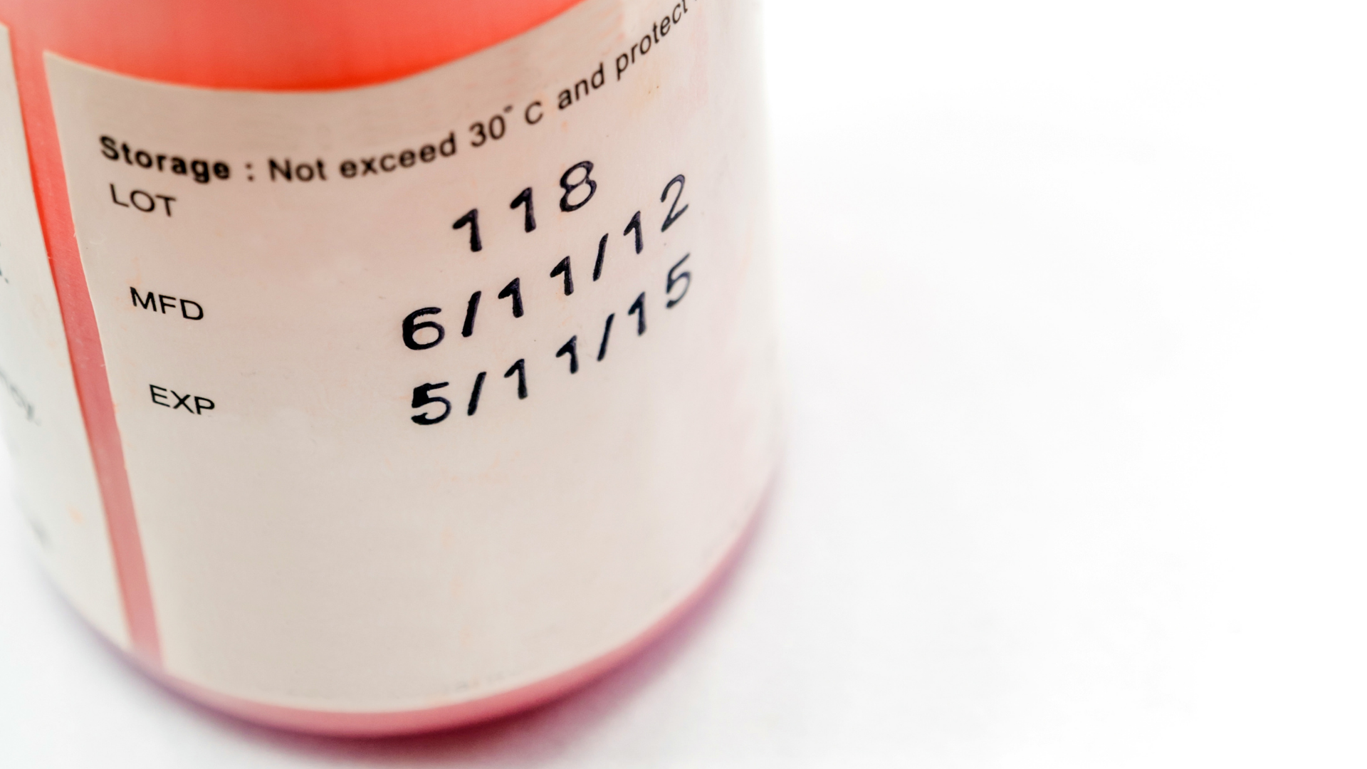 Zoom up of a pill bottle with the expiry date