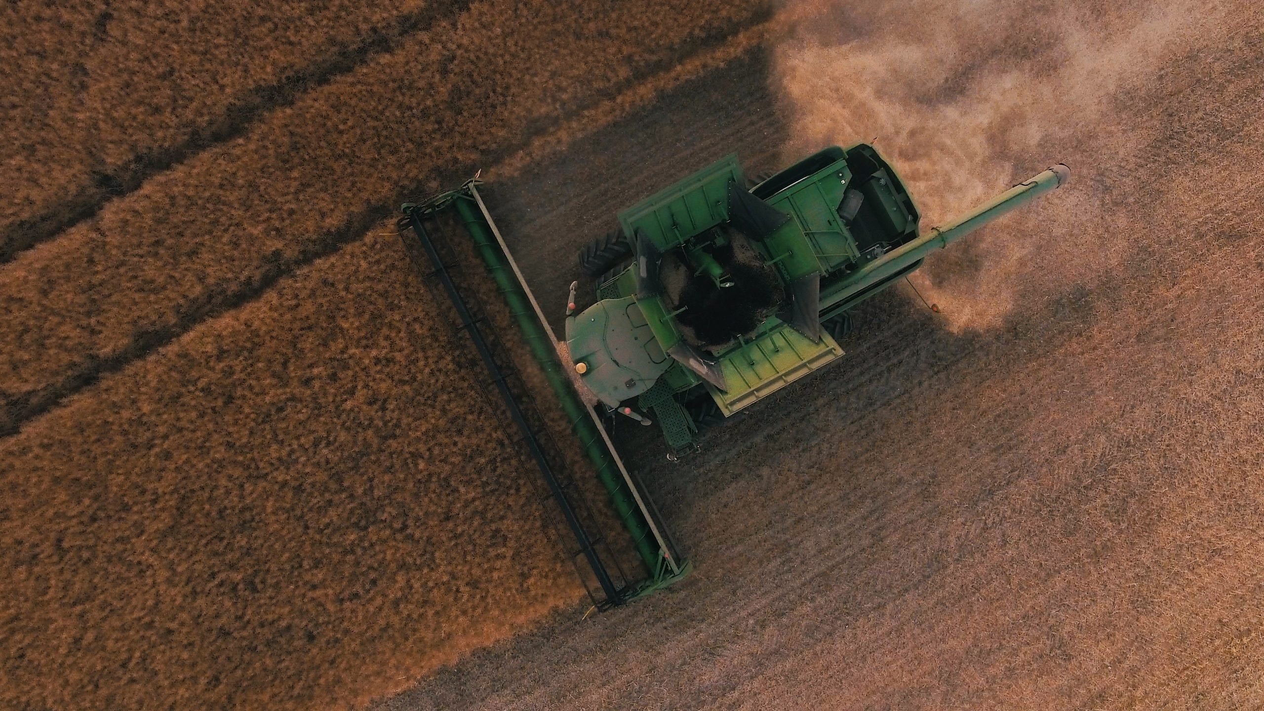 Aerial shot of tractor on a farm clearing crops