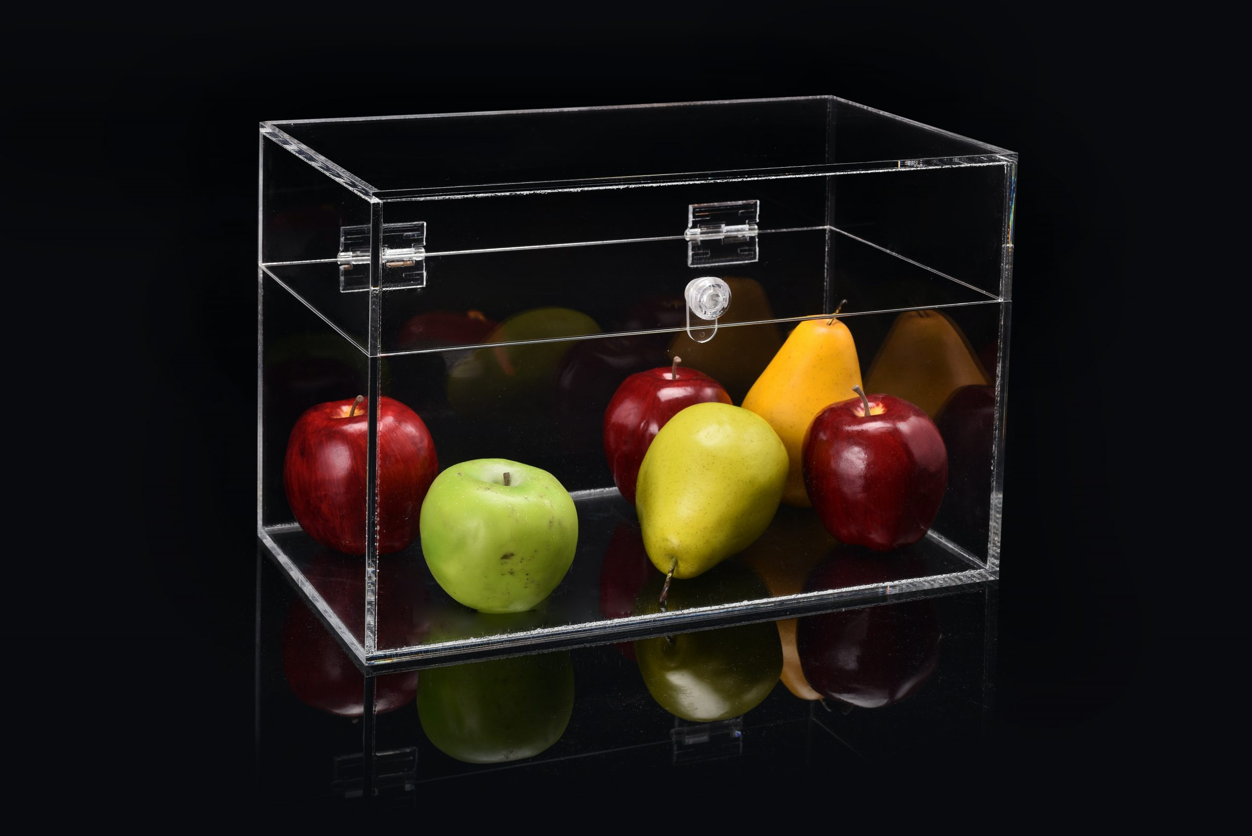 Clear rectangular box container fruits like pears and apples