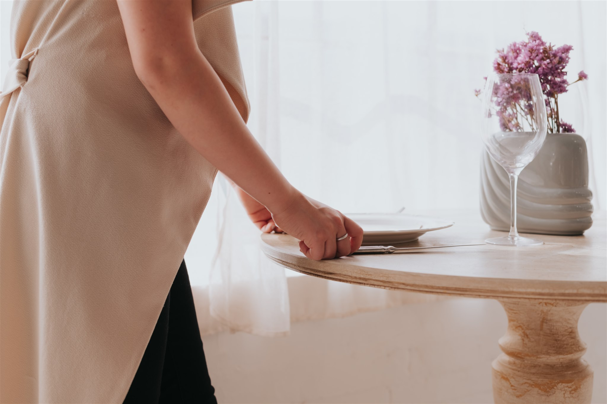 Close up of woman setting a table